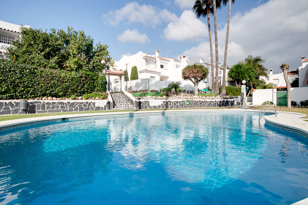 This townhouse would make a great family home, it is located in a quiet urbanisation with many famil,Spain