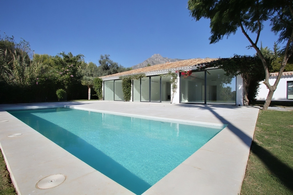 Completely reformed four bedroom south facing villa, on Marbella's Golden Mile, in a private and qui,Spain