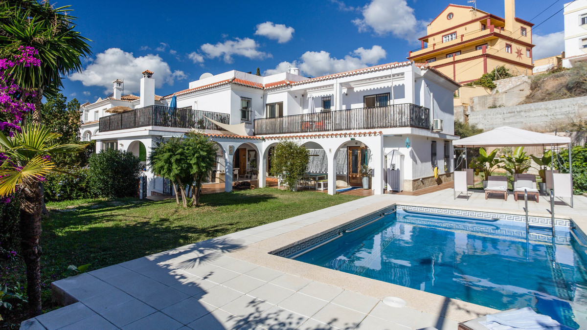 This wonderful house is located in a quiet urbanization. From the garden and from all terraces you h,Spain