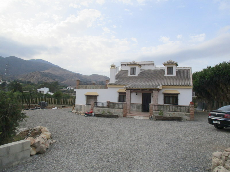 This very pretty, quality built, country villa is located within a 3.725 m2 of land planted out with,Spain