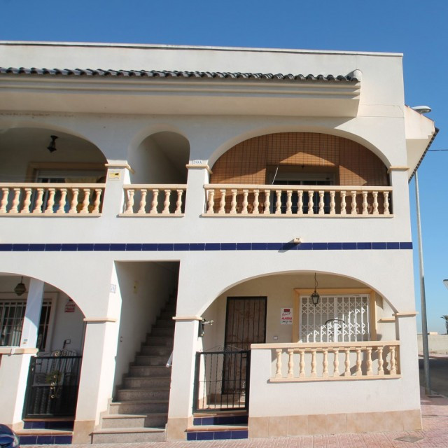 This well maintained corner bungalow located on the edge of a traditional Spanish village offers 2 b,Spain