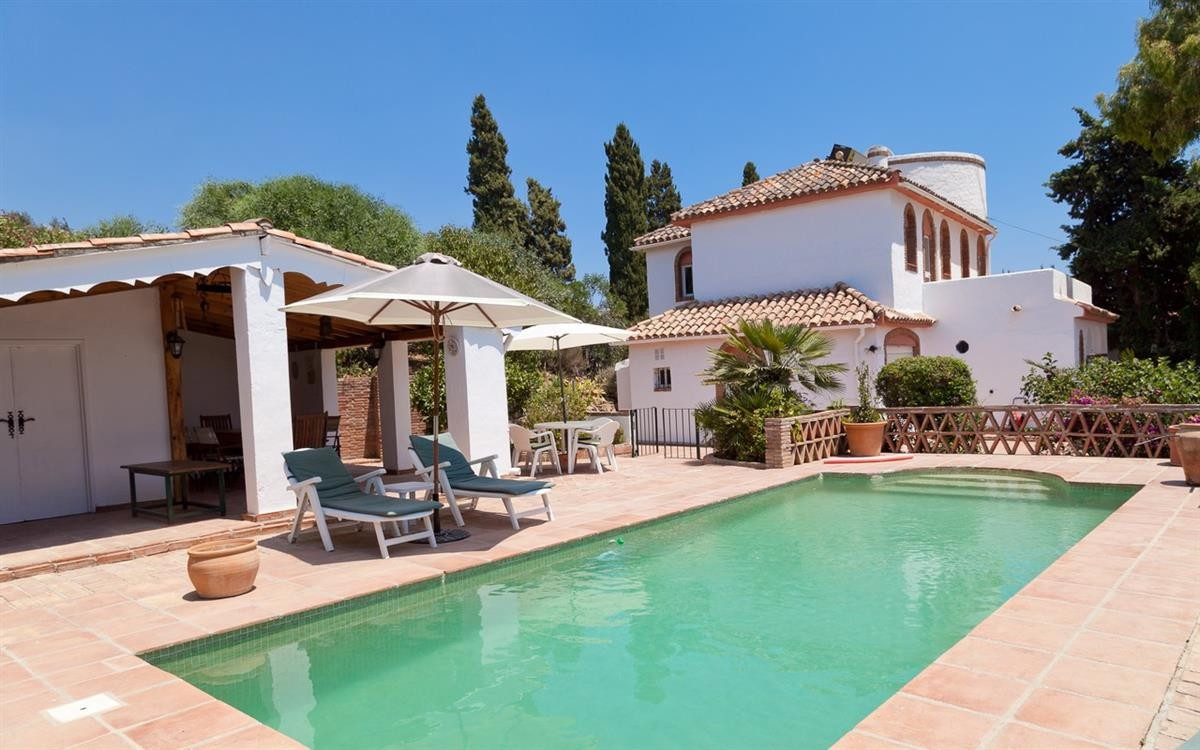 This fantastic villa has a most inviting area for sunbathing and barbecues next to the private pool., Spain