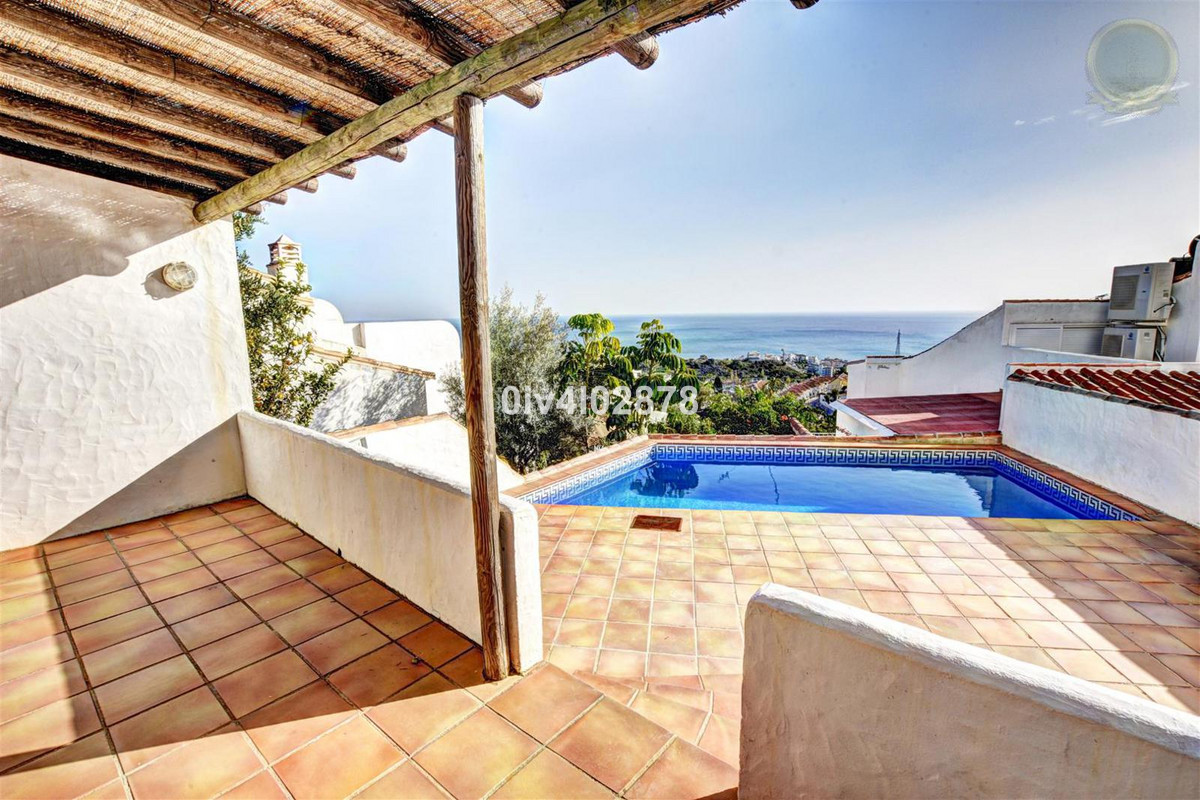 A lovely bright semi-detached villa with private pool located in a tranquil Andalucian part of Benal, Spain