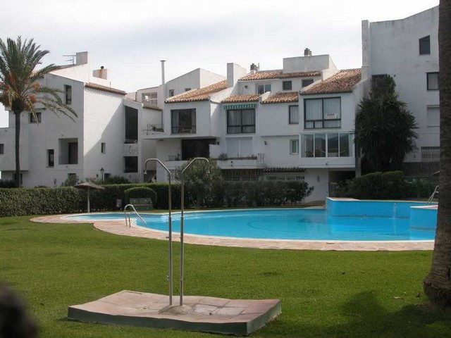 Townhouse,  First Line Beach,  Fitted Kitchen,  Parking: Carport,  Pool: Communal Pool,  Garden: Com, Spain