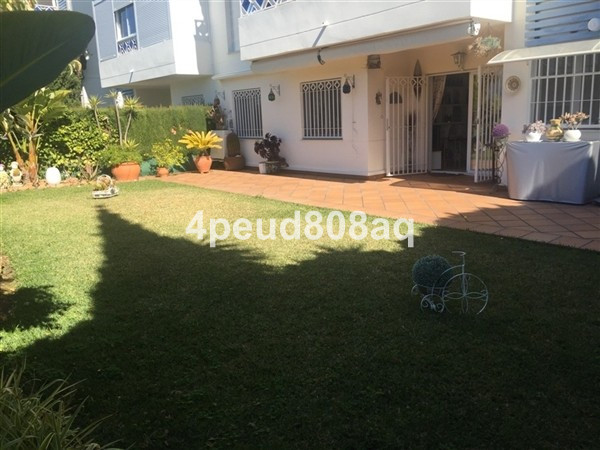 West facing partly furnished garden apartment located within Napoleon building, a beachside developm,Spain
