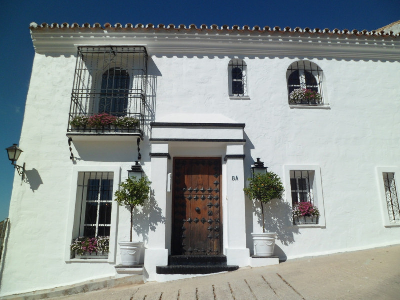 A Superb village town house with a private pool and garage offering stunning panoramic mountain and , Spain