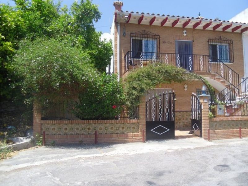 This semi-detached villa has a lovely gated entrance, a variety of terraces both covered and sunny a, Spain
