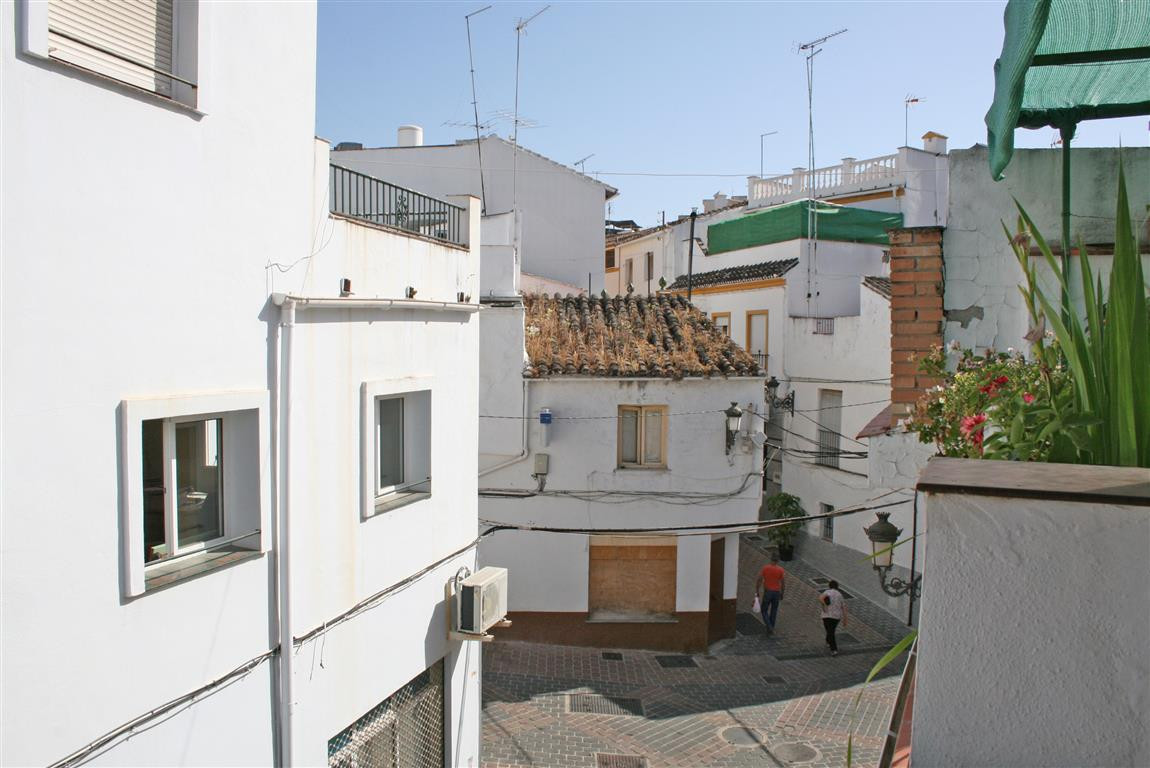 Townhouse with terrace located in the centre of Coin. The property needs a complete reform but has g, Spain