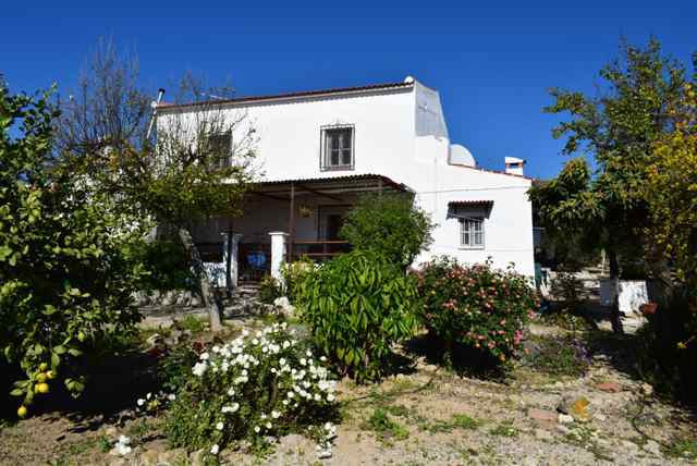 A charming country property situated on a large plot of land in a small hamlet close to the village , Spain