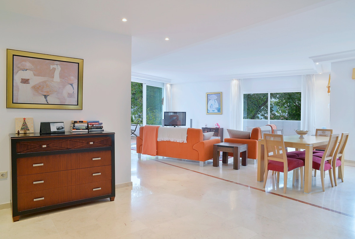 A large beachside apartment for sale in a gated complex of Jardines de Ventura del Mar, in Marbella,, Spain