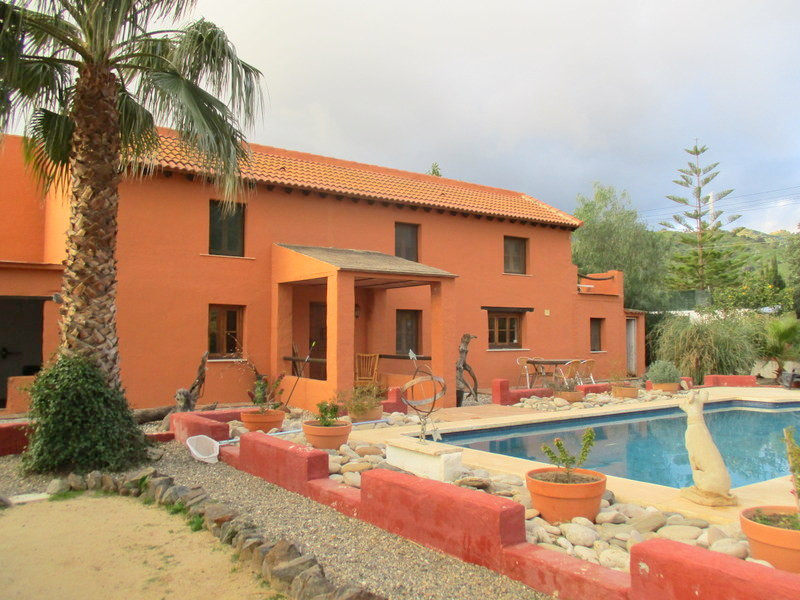 This fully restored cortijo style property is set within  1,000m2 of urban land located on the edge ,Spain
