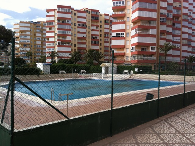 Apartment with two bedrooms located just 50m from the beach.  Located in a lovely with gardens, pool, Spain