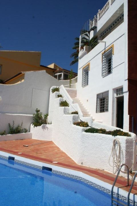 The main property has an open style ground floor with the fully-fitted kitchen of Swiss style, a din,Spain