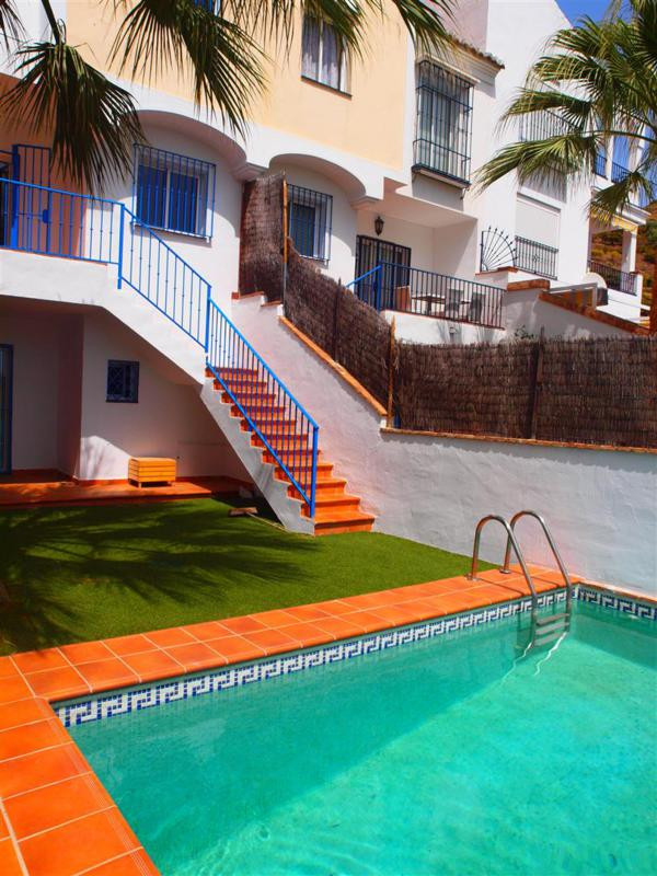 Beautiful townhouse in Torrox with spectacular views. This House consists of a living room with fire,Spain