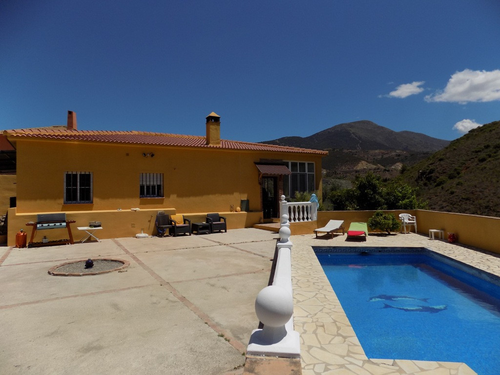 The property is accessed from a country lane through a large entrance gate and the upper level is fu,Spain