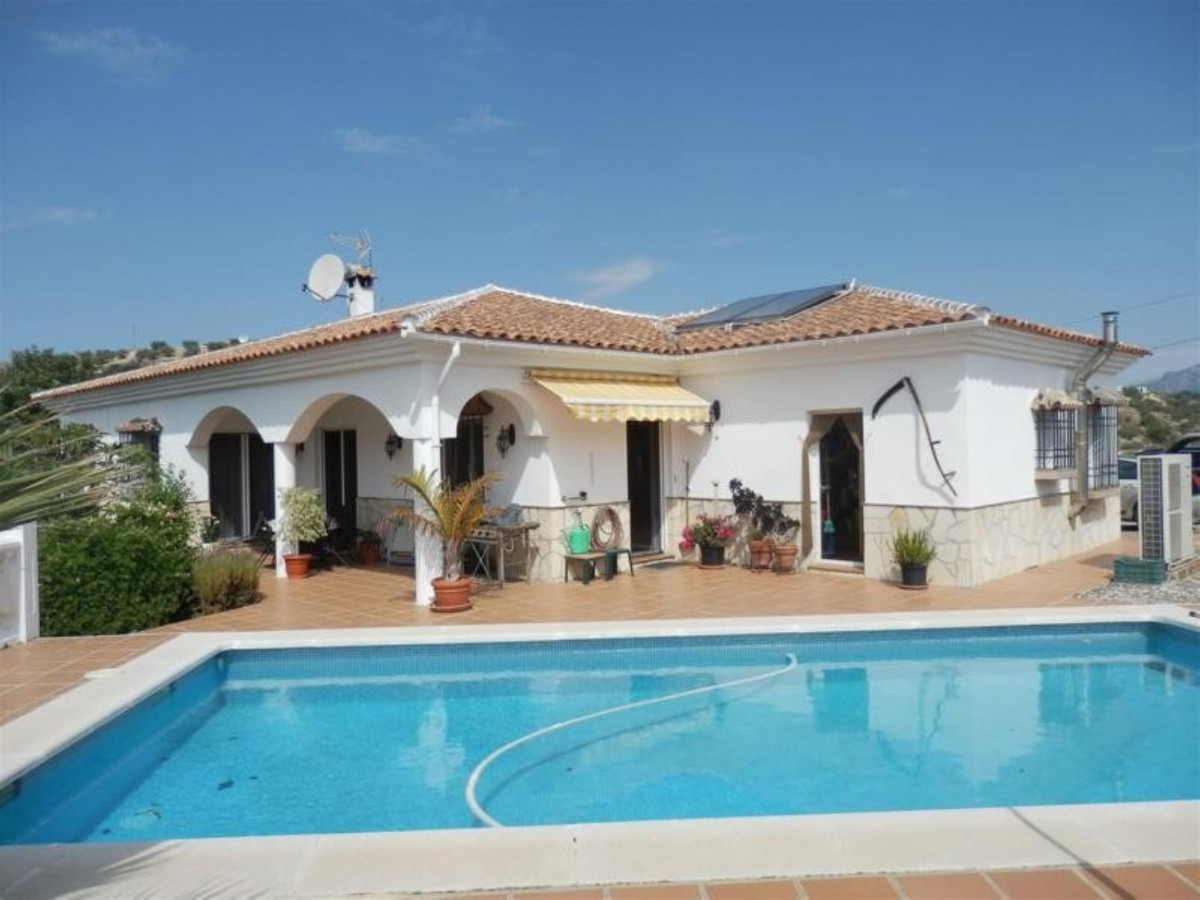Beautiful estate with views to the mountain in La Vinuela. This House consists of a living room with,Spain