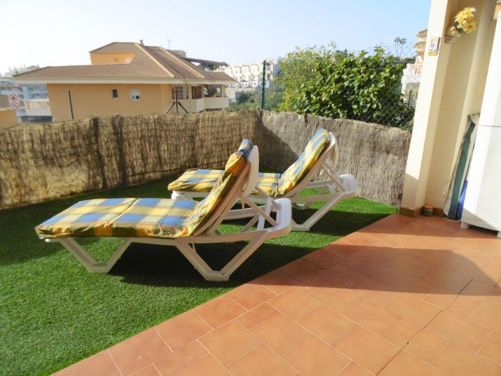 Sunny garden apartment for sale in Fuengirola, on the Costa del Sol, close to sea and tren. This pro, Spain