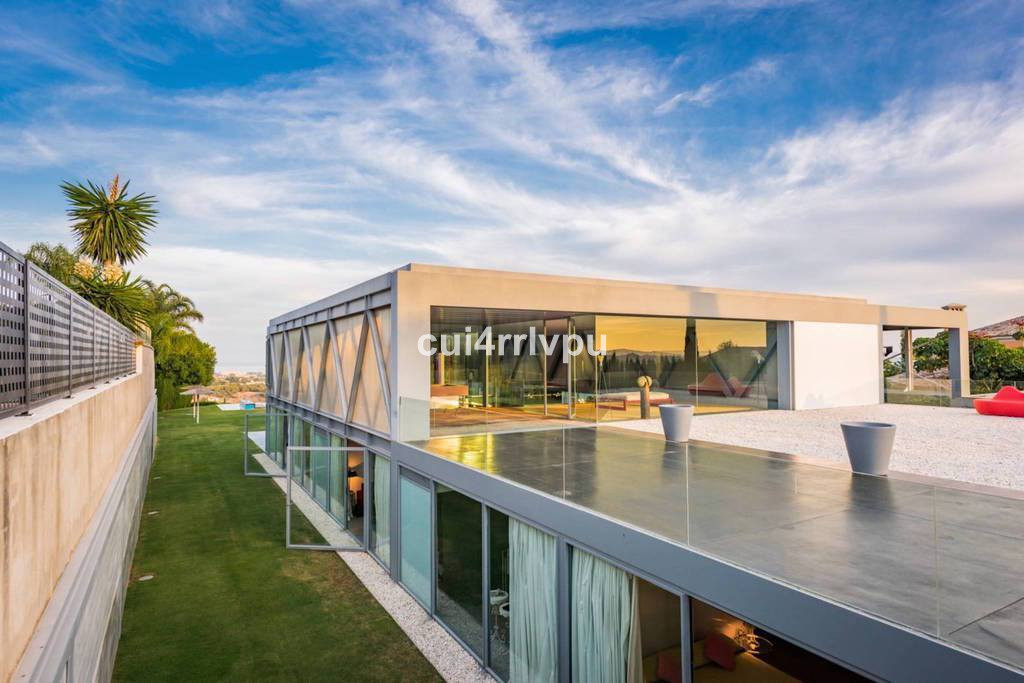 A stunning modern villa built completely open plan with glass walls where interior and exterior merg,Spain