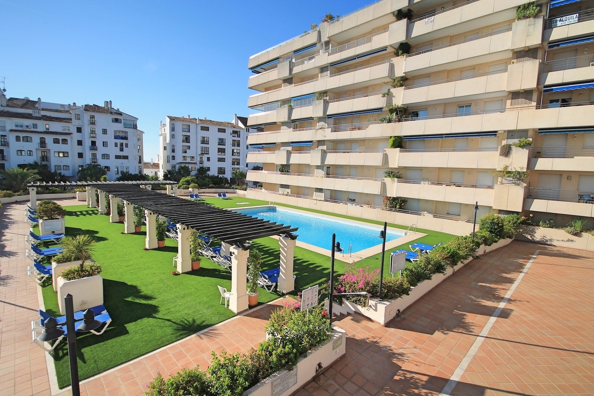 Three bedroom, two bathroom, second floor apartment, centrally located in Puerto Banus with south fa,Spain