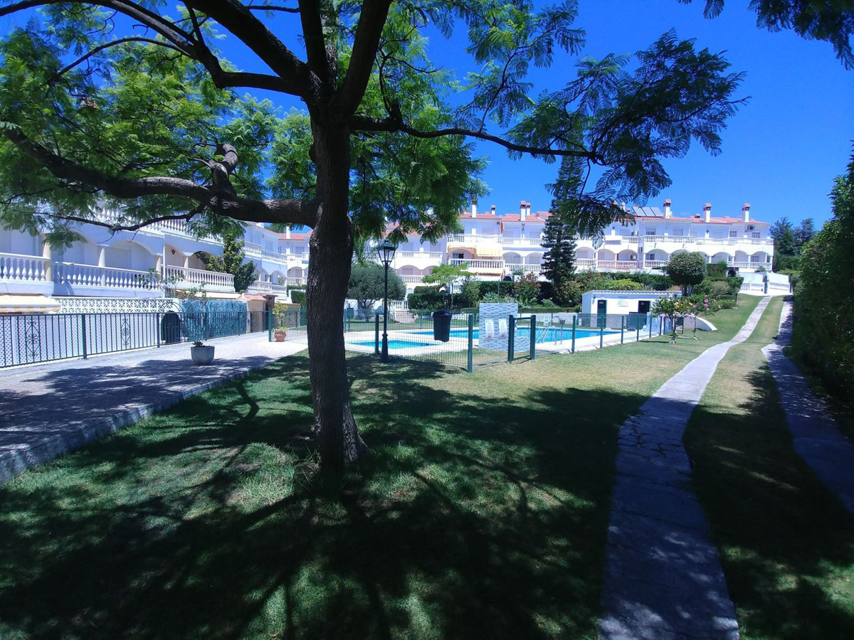 Townhouse in gated community, being in reality semi-detached. Gated community with large gardens and, Spain