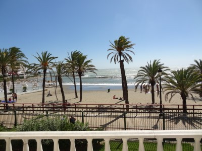 This large beachfront garden duplex has been divided into 4 separate apartments sharing a common ent,Spain