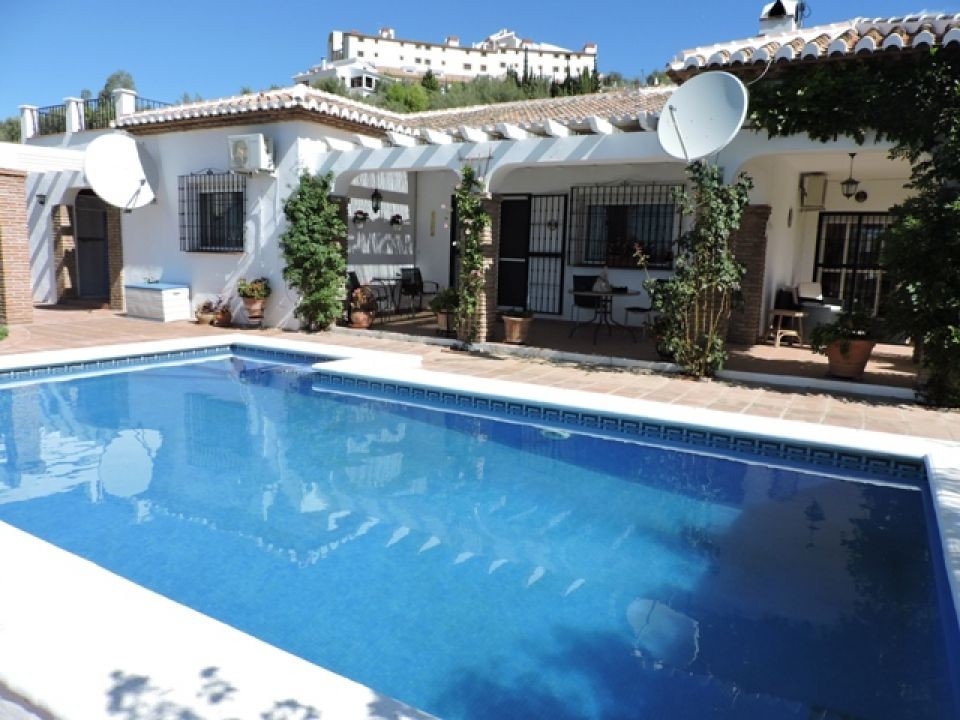 A very special south-facing property located in the pretty mountain village of Alcaucin and with stu,Spain
