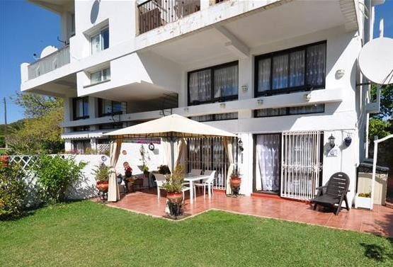 Cozy ground floor duplex, with direct access to the private garden, to the communal swimming pool an,Spain