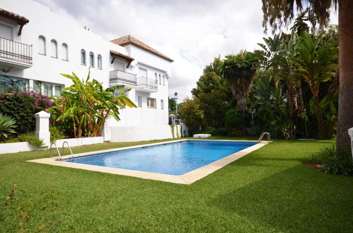 BEACHSIDE MARBELLA: This fantastic three bedroom townhouse is located within a very small private ga,Spain