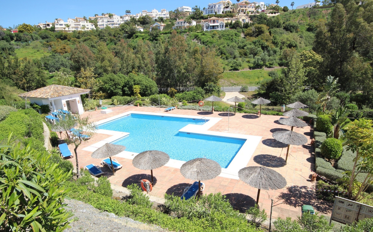 A beautifully presented three bedroom ground floor apartment with garden terrace and underground par, Spain