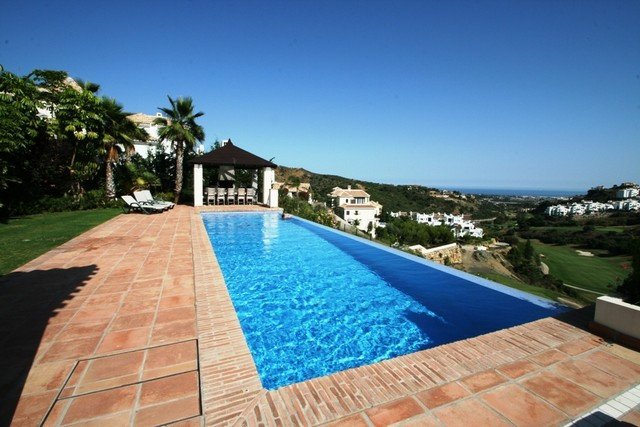 Modern south facing family villa located in a frontline golf position in Lomas de La Quinta, a gated, Spain