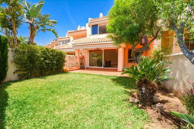 Nice Townhouse in Benalmadena with large garden and just 5 minutes from the beach and amenities.  It, Spain
