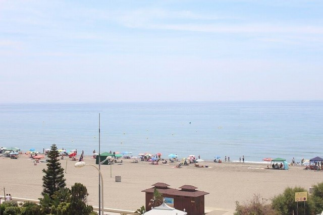 Lovely first line beach penthouse with incredible sea views. Located right on the beachfront within ,Spain