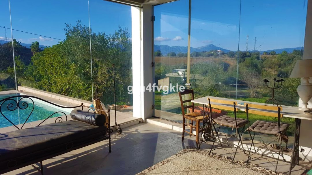 house 1 km from coin in the upper part (near school and institute), 20 km from Marbella and 35 kms f,Spain