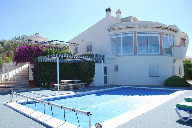 LAKESIDE VILLA WITH STUNNING VIEWS OVER LAKE VINUELA. Backdrop of mountains and sweeping vistas over,Spain