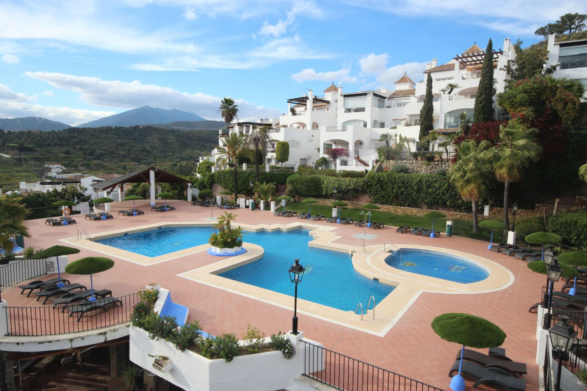 This charming bright, top floor south facing one bedroom apartment is surrounded by a wonderful natu,Spain