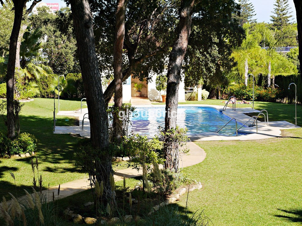 Top floor apartment located within a secure complex with communal gardens, pool and parking faciliti,Spain