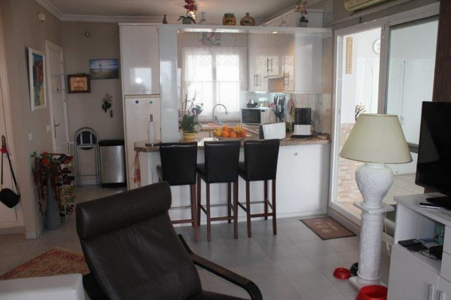 This wonderful 1 bedroom penthouse is situated on a high level and offers stunning views towards the,Spain