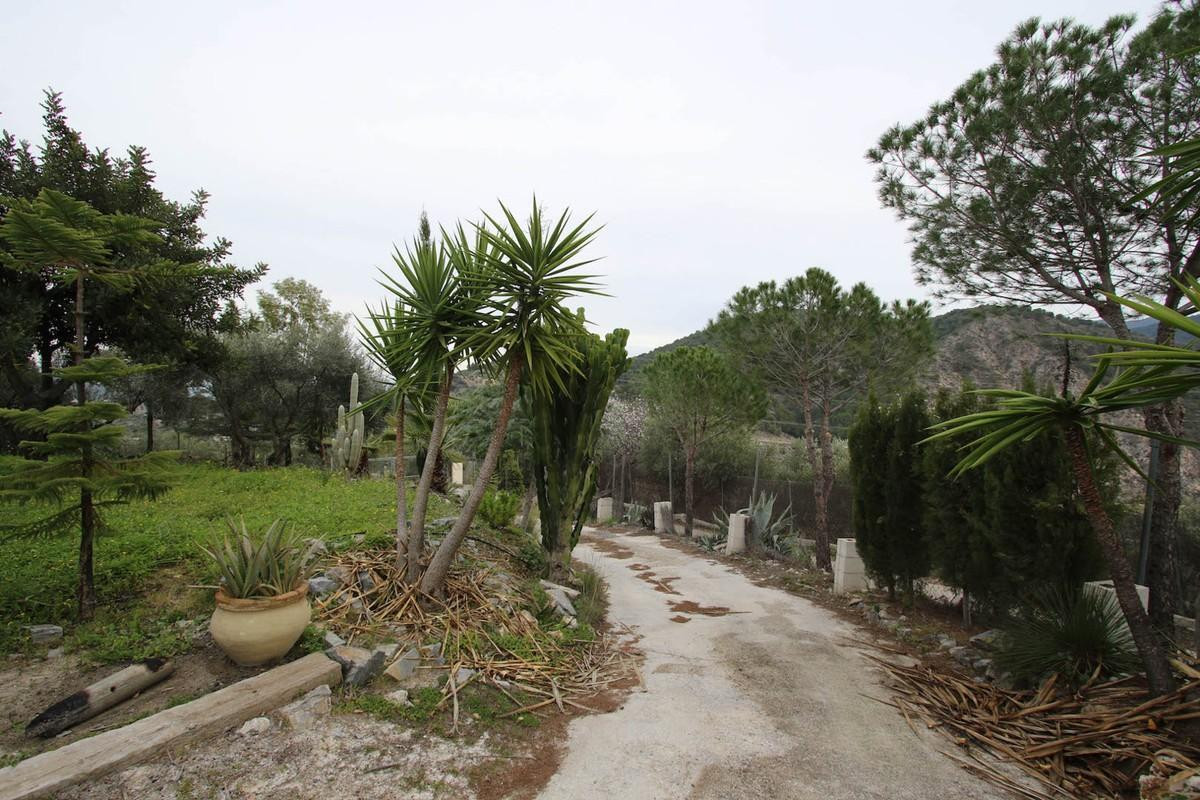 Plot of Land with two buildings in a great location. A 5 minute walk from the Marbella Design Academ, Spain