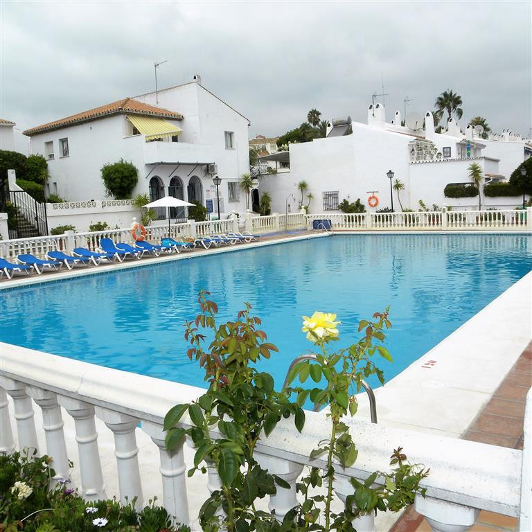 This 2 bed townhouse is on the market and in need of cosmetic renovation. It has plenty of outside s,Spain
