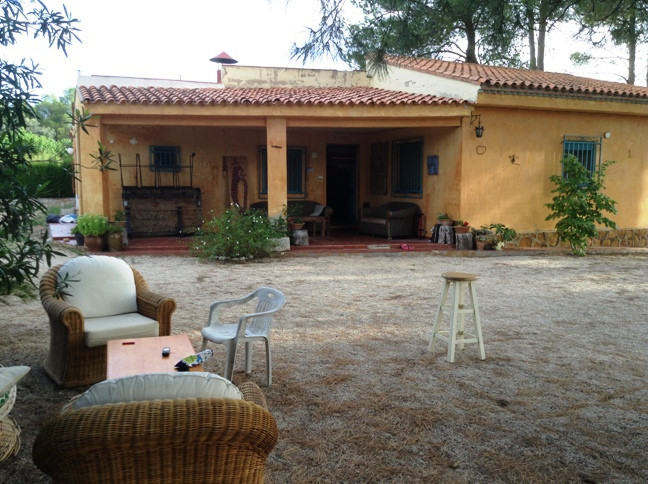 Pretty house in need of cosmetic work in the main house. 4 double rooms, 2 bathrooms and separate an,Spain