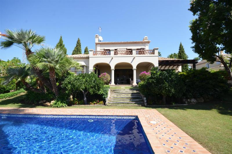 Beautiful traditional-style four bedroom family villa situated in a highly prestigious community loc, Spain