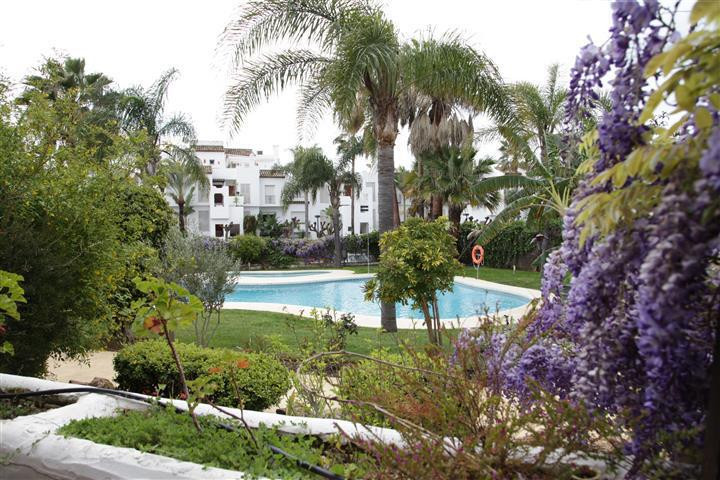 This is a gorgeous south facing beach side apartment is located in a gated complex in the Cancelada ,Spain