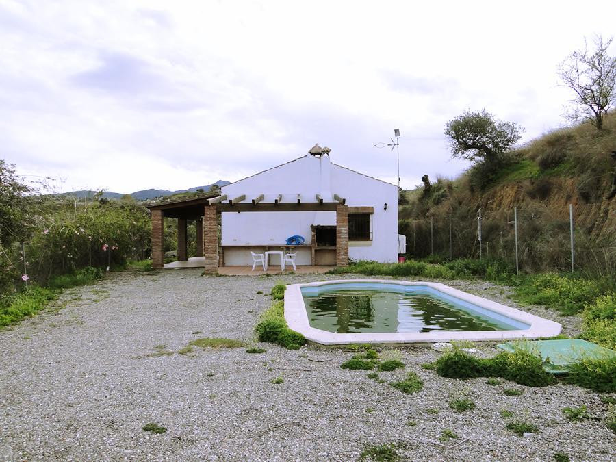 Small 2 bedroom country finca perched on a large plot with panoramic views.  The property has a low ,Spain