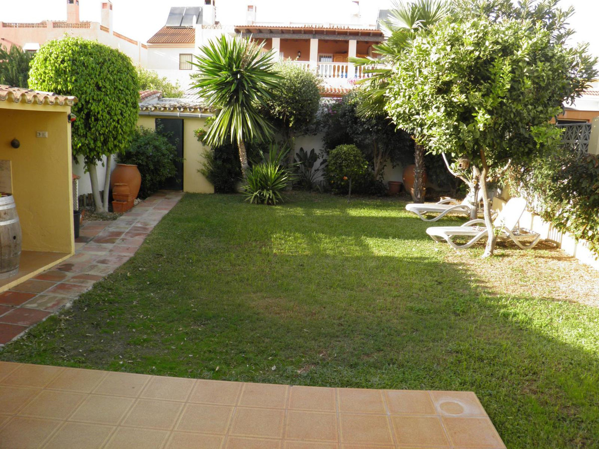 Beautiful villa, situated within a gated community with communal pool and close to beautiful green a,Spain
