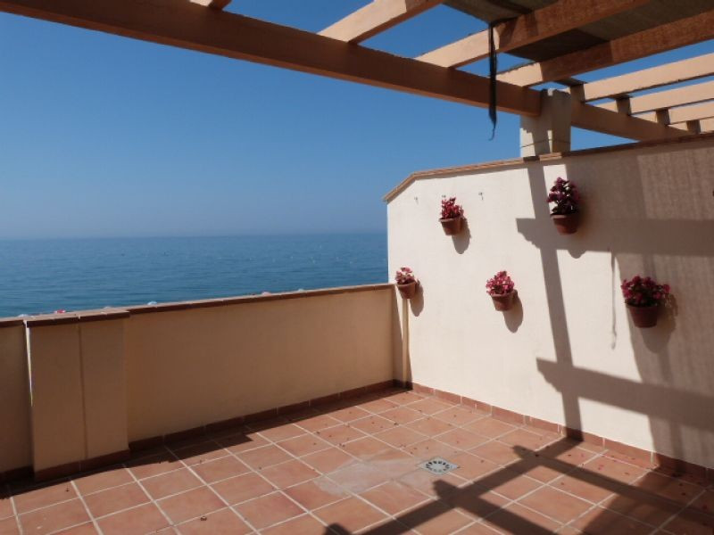 This lovely property is front-line to the beach. The house is entered via a large terrace with BBQ w,Spain
