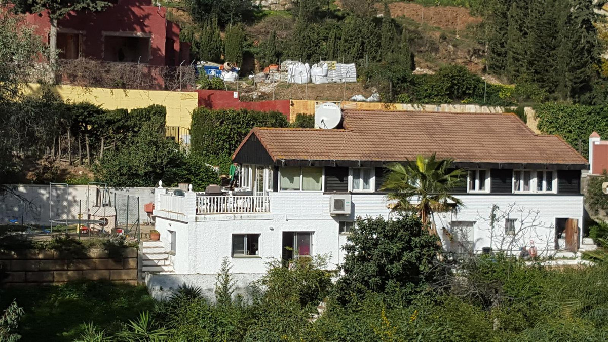A large south facing fenced and gated villa in Campo Mijas on a large plot with off street parking f, Spain