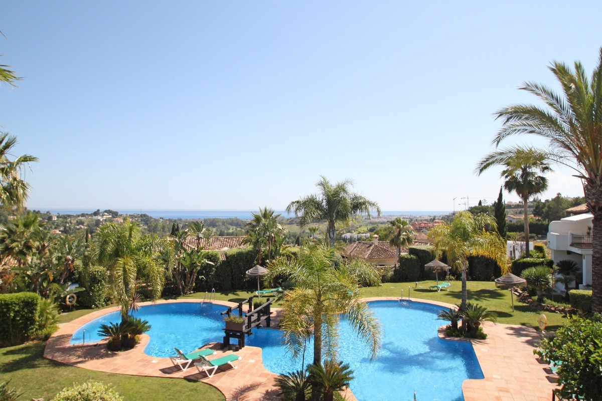 South-West facing three bedroom corner townhouse with sea views set in the sought after complex of M,Spain