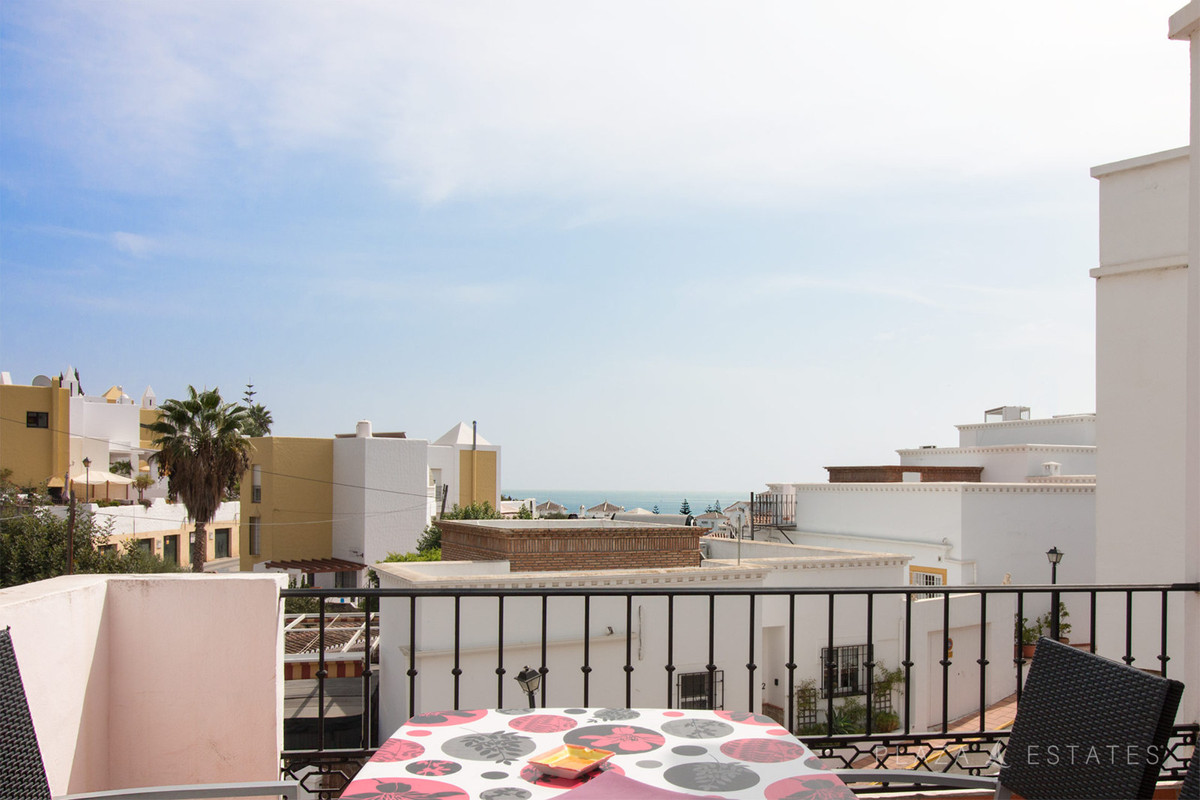 Bright duplex for sale in Nerja with independent main entrance, ample terrace and communal pool. The, Spain
