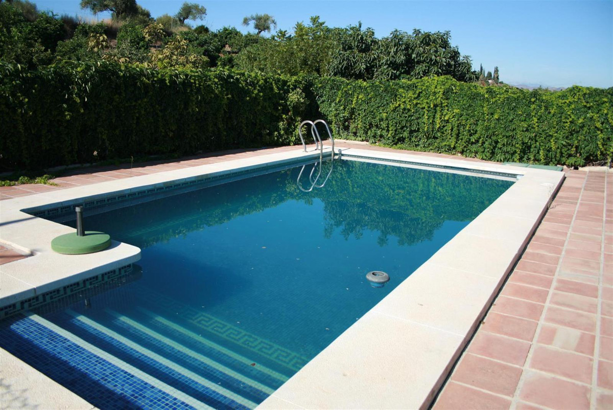 Country property with beautiful views in Coin. The property benefits from productive avocado and wal,Spain