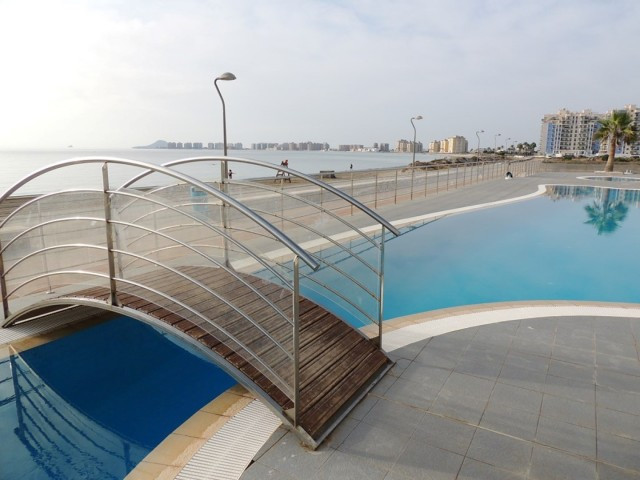 Modern duplex penthouse, newly built in la Manga del Mar Menor, in front of the beach and close to a Spain